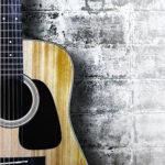 27877093 - guitar on grunge background.