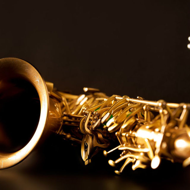 17606713 - classic music sax tenor saxophone and clarinet in black background